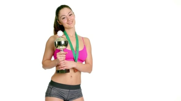 Thumbnail for Happy Sports Woman Holding Winner Cup And a Medal Isolated