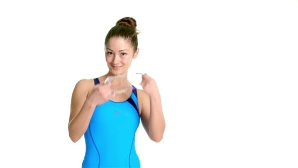 Thumbnail for Woman In Swimsuit Puts On Swimming Glasses