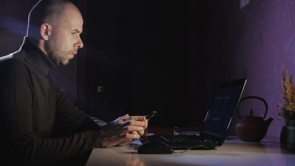 Thumbnail for Portrait of a Man on His Laptop at Night With a Face of Concentration.