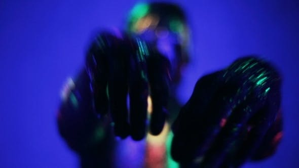 Thumbnail for Man's Hands Glow In Ultraviolet Light