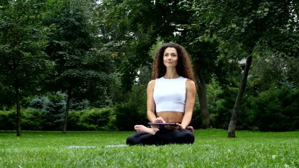 Thumbnail for Woman Doing Yoga In Park And Work On Tablet