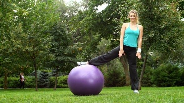Thumbnail for Girl Doing Side Split With Ball In Park