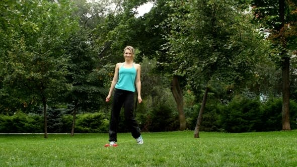 Thumbnail for Girl Engages With Dumbbells In Park