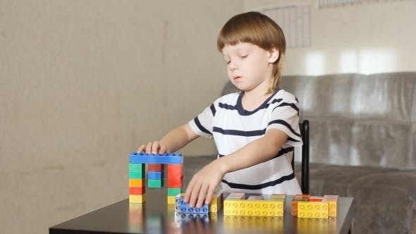 Thumbnail for Boy Playing With Lots Of Colorful Plastic Blocks Indoor