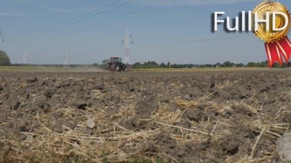 Cover Image for Soil With Straw, Tractor is Plowing