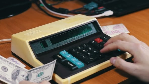 Thumbnail for Counting Money On a Old Calculator
