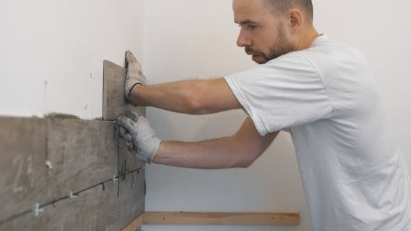 Thumbnail for Home Improvement, Renovation - Construction Worker Tiler Is Tiling, Ceramic Tile Wall Adhesive