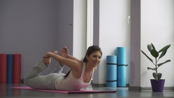 Thumbnail for Woman Doing   Exercises For Flexibility In Gym On The Floor