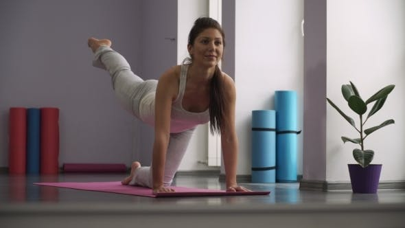 Thumbnail for Woman Doing Exercises For Legs On Exercise Mats