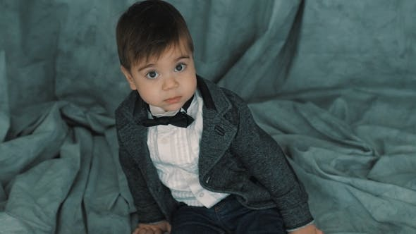 Thumbnail for Little Cute Boy In Bowtie Smiling, Making Funny Faces, Stylish Casual Kid