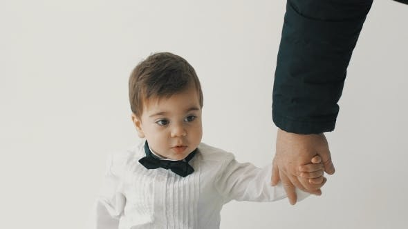 Thumbnail for Little Son Hold His Father For Hand