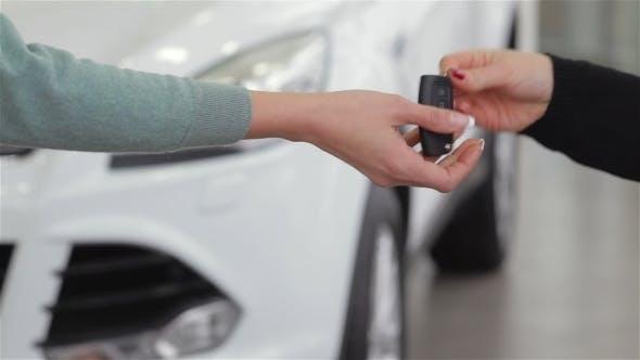 Thumbnail for Saleswoman Giving Car Key