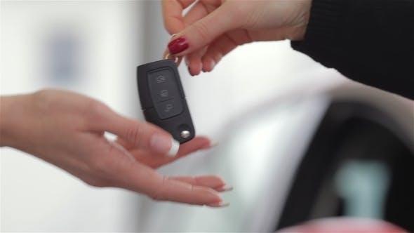 Car Dealer Gives The Customer The Car Keys
