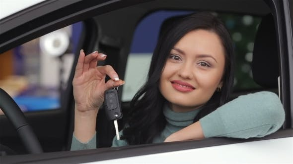 Thumbnail for Smiling Woman Showing The Car Key