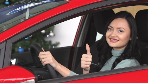 Thumbnail for Buyer Woman Doing Thumps-up In Car