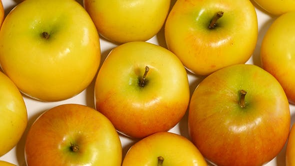 Thumbnail for Rotating Yellow Apples