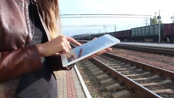 Thumbnail for Woman At The Station Using The Touchpad