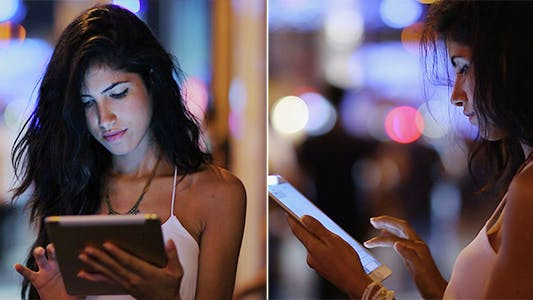 Cover Image for Woman Using Tablet At Night