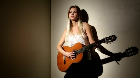 Thumbnail for Girl Playing Guitar Near The Wall