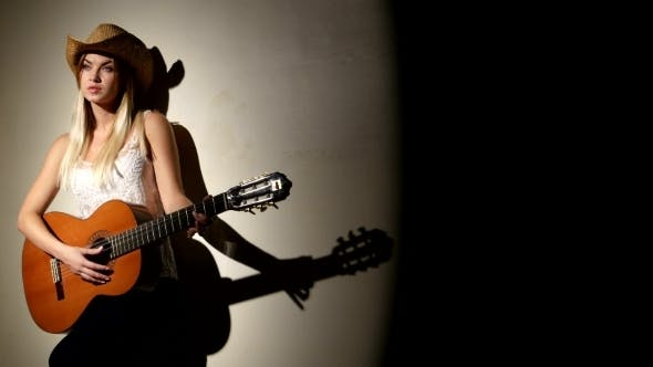 Thumbnail for Beautiful Girl In Cowboy Hat Playing Guitar