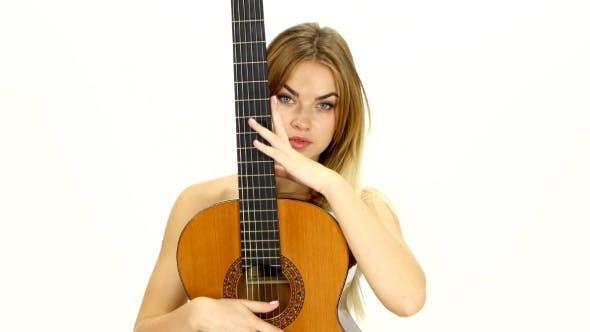 Thumbnail for Naked Blonde Girl Touching Guitar