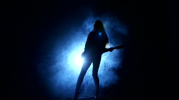 Thumbnail for Girl Playing Guitar In Silhouette
