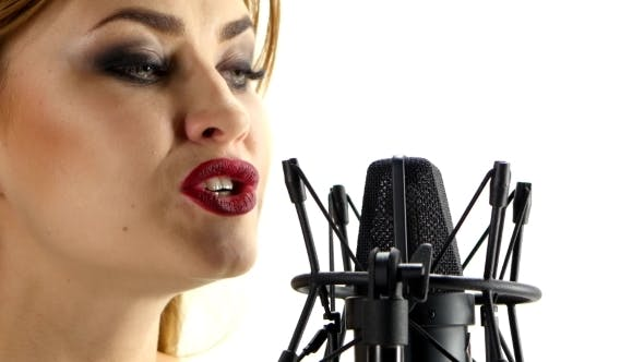 Thumbnail for Young Blonde Woman Signing In Microphone