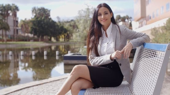 Thumbnail for Gorgeous Business Woman Sitting On Bench