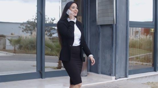 Thumbnail for Businesswoman Walking Through An Office Complex