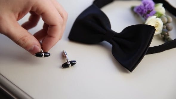 Thumbnail for Groom Takes His Cufflinks