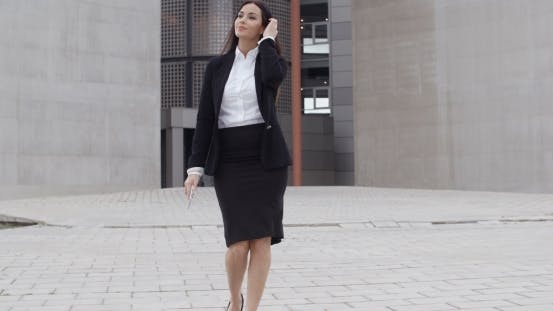 Thumbnail for Young Businesswoman Walking Towards The Camera