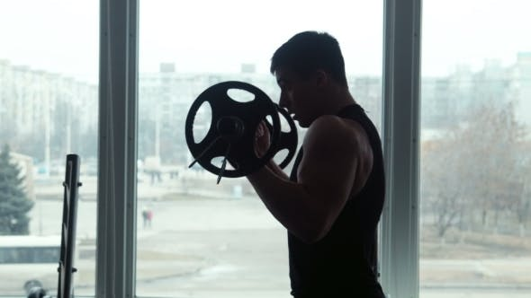 Thumbnail for Athlete Lifts Barbell In Gym