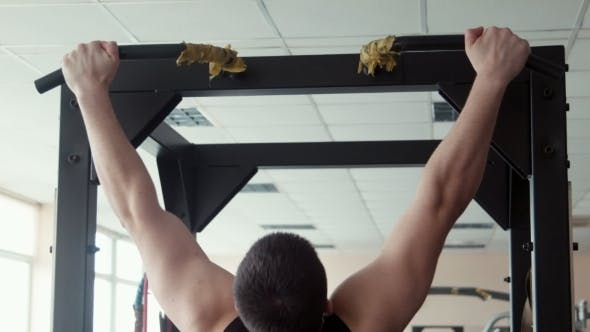 Thumbnail for Male Bodybuilder Pulling Up in a Gym