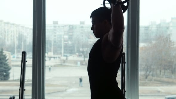 Thumbnail for Silhouette Athlete Lifts Barbell In Gym