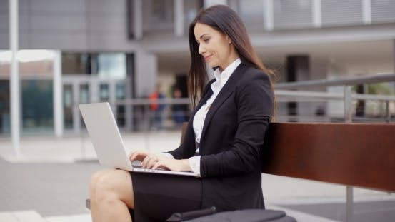 Thumbnail for Business Woman Alone With Laptop On Bench