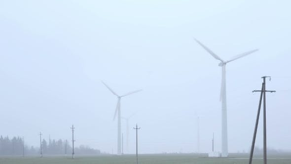 Thumbnail for Windmills Near The Road Foggy Morning.