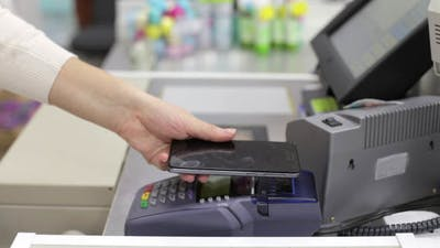 Woman Pays Terminal