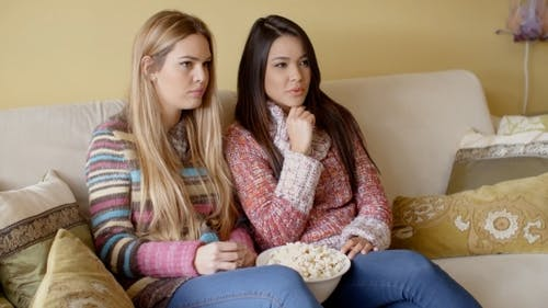 Girls Watching Movie At Home With Snacks