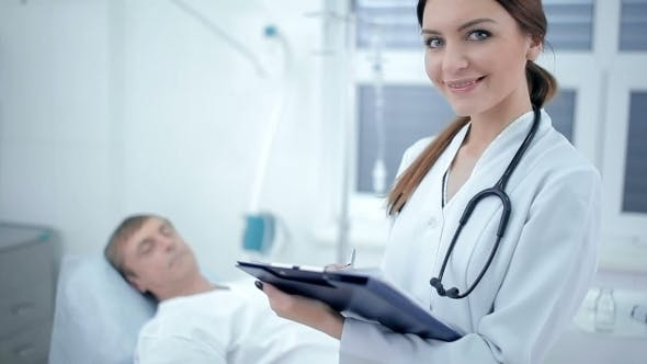 Cover Image for Beautiful Female Doctor With Patient On Background