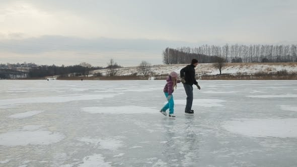 Thumbnail for Father With Daughter Ice Skating On Frozen Lake