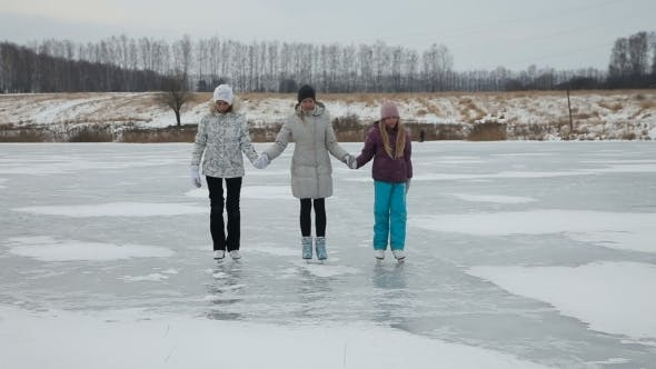 Thumbnail for Family Ice Skating On Frozen Lake