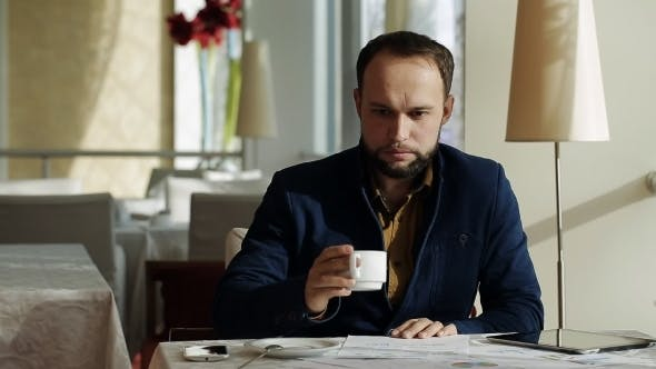 Thumbnail for Good-looking Manager Using Tablet And Graph In Coffee Shop