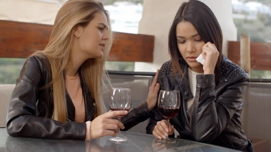 Thumbnail for Woman Drinking With Weeping Friend