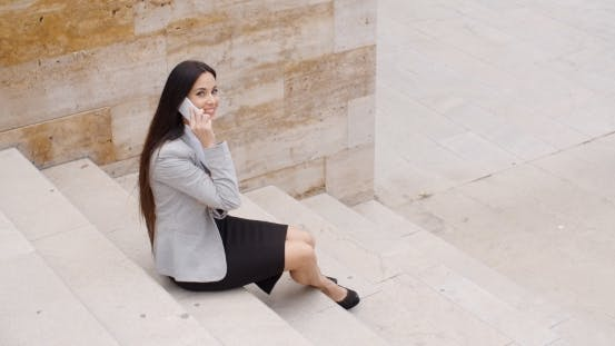 Thumbnail for Cute Business Woman Sitting On Steps With Phone