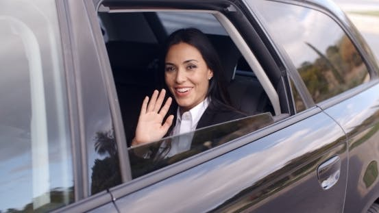 Thumbnail for Cute Business Woman Sitting In Car Waving Hand