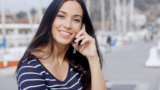 Thumbnail for Attractive Smiling Woman Using a Mobile Phone