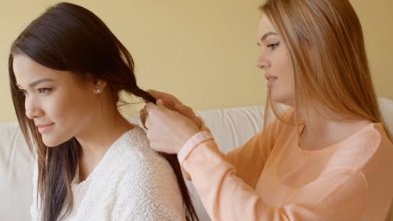 Thumbnail for Pretty Woman Fixing The Hair Of Her Friend