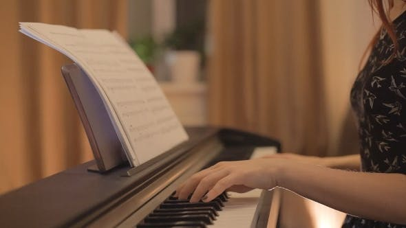 Thumbnail for Young Girl Playing The Piano