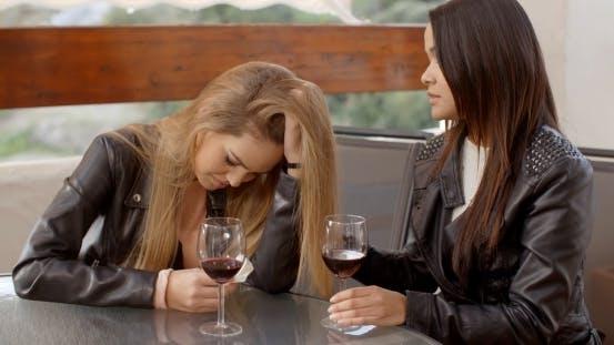 Thumbnail for Pair Of Sad Women Drinking Wine