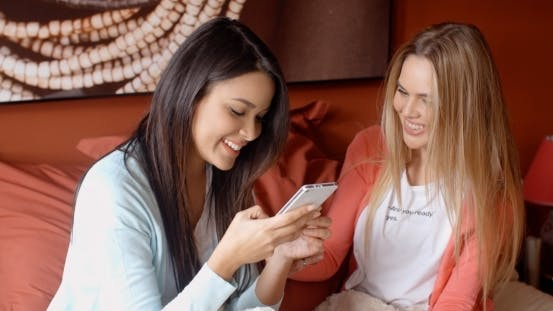 Thumbnail for Female Friends Texting Together